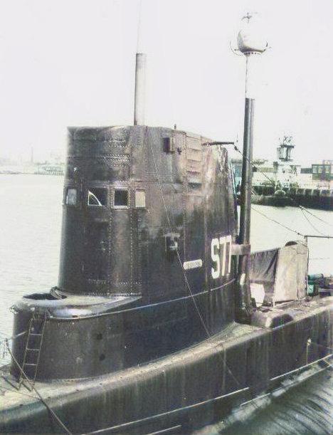 HMS Tireless streamlined with snort mast raised.