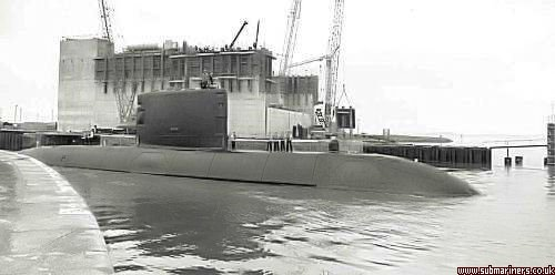HMS Upholder entering Walney Channel. The new dock gates to accommodate Trident were under construction in the background